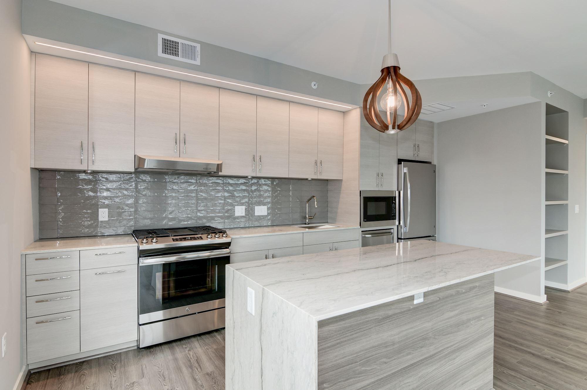 Kitchen with gas range, sink, fridge